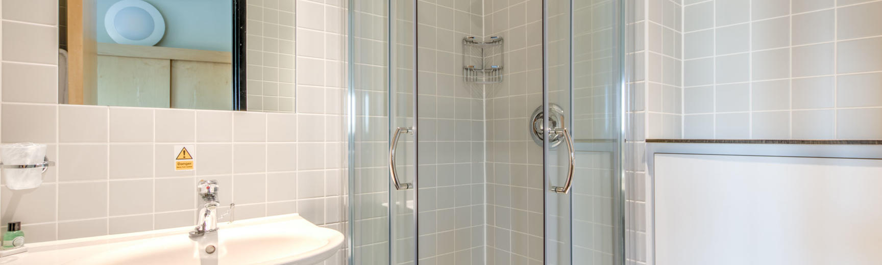 Photo of a bathroom with shower and washbasin