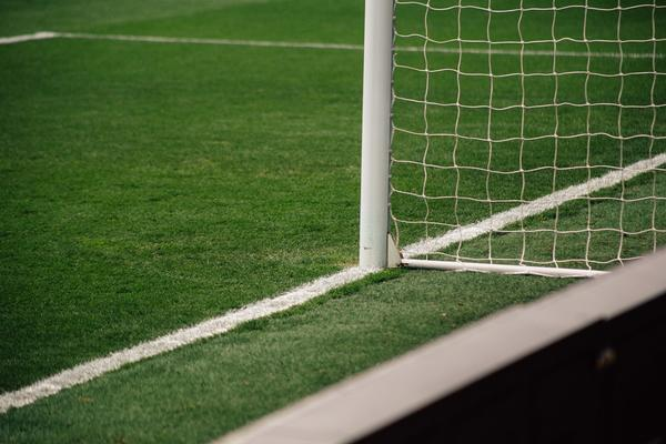 Close up photo of a goal post on a football pitch