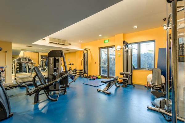 Photo of a gym with various cardio and resistance equipment