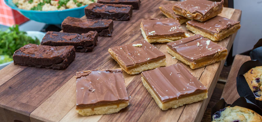 Photo of caramel shortbread and brownies arranged on a serving board